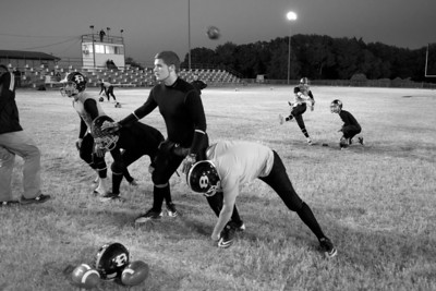 The team runs through kicking drills before their final regular season game against division rival Calvert.