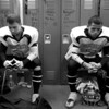 Dustin Barker (left) and William Watson (right) get focused in the locker room before the last game of the season on November 5, 2010 against Calvert, their division rival.  Calvert won 46-0.