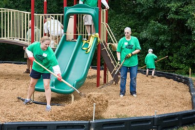 Kristin Fulcher and Helen Buckley spread mulch.