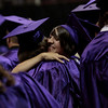 Montgomery High School graduates share a congratulatory hug during commencement ceremonies Saturday at Reed Arena in College Station. (text by Eric Swist)