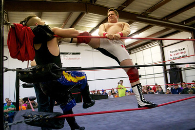 Bishop chokes newcomer Earl Ray with his foot in the second match of the night.