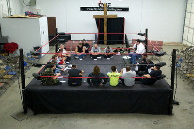 The wrestlers from the Christian Wrestling Federation meet shortly before the matches begin to pray, sing worship songs, and plan the matches and basic script for the night.