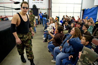 Private First Class Ronny Graham and his manager Major Inconvenience get booed by the crowd as they makes their entrance for a match.  The CWF has good characters and bad characters and the crowd is encouraged to boo and cheer for each wrestler respectively.