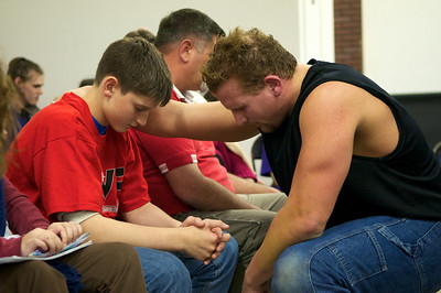 Jay, the current CWF champion, prays with a young fan who raised his hand during the message to say that he wants to accept Jesus as his savior.  The wrestlers pray with each person who raises their hand, approximately 15 people on this night.