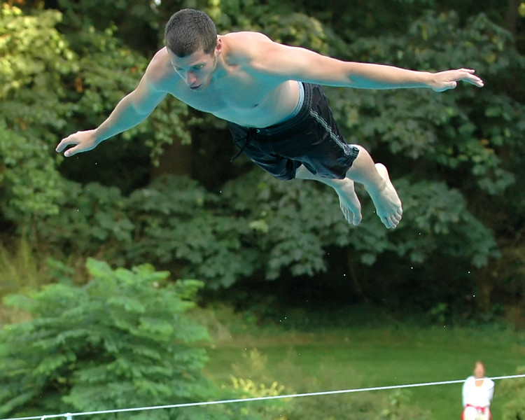 For the Enterprise/John Kossik<br /> Spencer Hart, 21 of Edmonds floats in the air in the bellyflop contest
