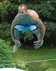 For the Enterprise/John Kossik<br /> Steve Powell, 27 of Marysville reaches for his ankles in his hallmark trick in the bellyflop contest