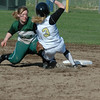 For the Enterprise/John Kossik<br /> Lynnwood's Chloe Goudzwaard gets caught trying to steal second by Mount Vernon's Allison Kutz in the first game of the District 1 3A Fastpitch Tourament