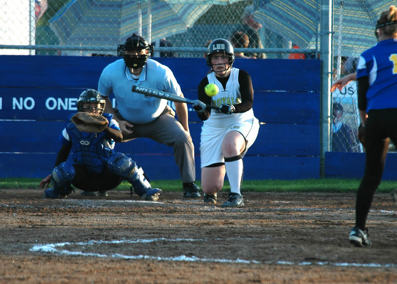 For the Enterprise/John Kossik<br /> Alexandra Kossik of Lynnwood lays down a bunt to load the bases in the late innings of their final game of the District 1 3A Fastpitch Tournament against Ferndale