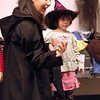 For the Enterprise/John Kossik<br /> Ray Liaw and her daughter Isis try on costumes at Costume swap sponsored by Green Halloween Edmonds