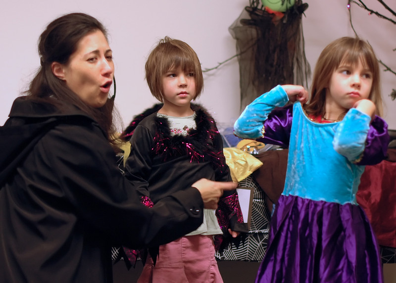 For the Enterprise/John Kossik<br /> Ray Liaw sizes up costumes for her daughters Isis and Inanna at Costume swap sponsored by Green Halloween Edmonds