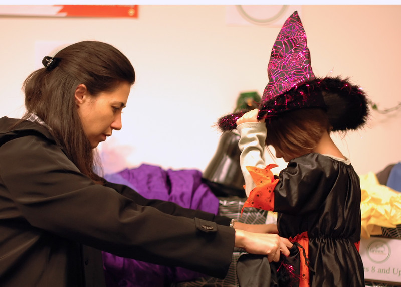 For the Enterprise/John Kossik<br /> Ray Liaw checks the size of a witch skirt on her daughter Isis at Costume swap sponsored by Green Halloween Edmonds