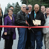 For the Enterprise/John Kossik<br /> Pat McMahan cuts the ribbon at 230th Street SW Reconstruction Ribbon Cutting Event on Saturday as Mayor Jerry Smith, members of the city council and city employees invovled in the project look on.