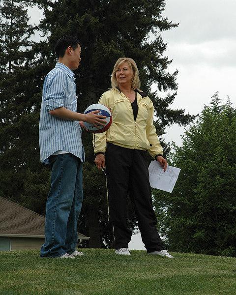 For the Enterprise/John Kossik<br /> Mill Creek's Recreation Supervisor pam Olsen congratulates Lester Kao for winning the contest for the naming of Hillside Park
