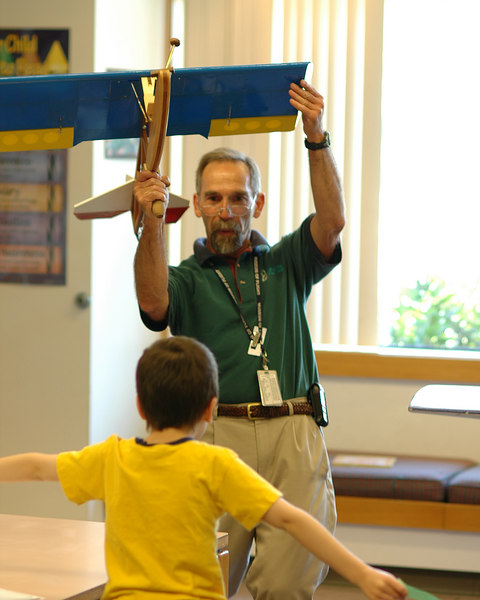 For the Enterprise/John Kossik<br /> James Moore of the Museum of Flight explains control surfaces of an airplane to young attendees of Jet Age Workshop at Mill Creek Library.