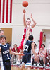 For the Enterprise/John Kossik<br /> King's Spencer Clark takes the jump shot past Sultan's RJ Perkins and Herb Webster