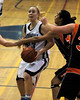 For the Enterprise/John Kossik<br /> Marelle Moehrle trys to take the ball to the hoop through a sea of Monroe arms including those of Jordyn Battle.