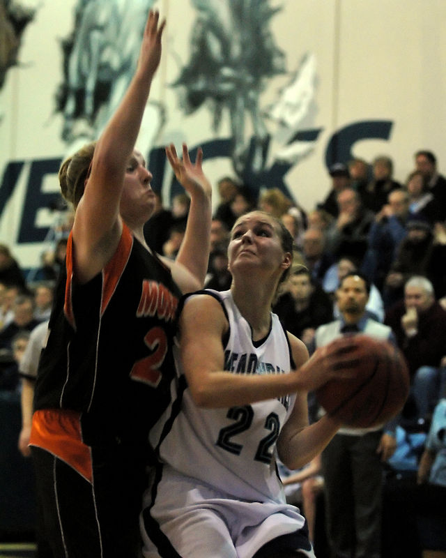 For the Enterprise/John Kossik<br /> Monroe's Keena Hopkins challanges Meadowdale's Eryn Jones as see goes up for a layup