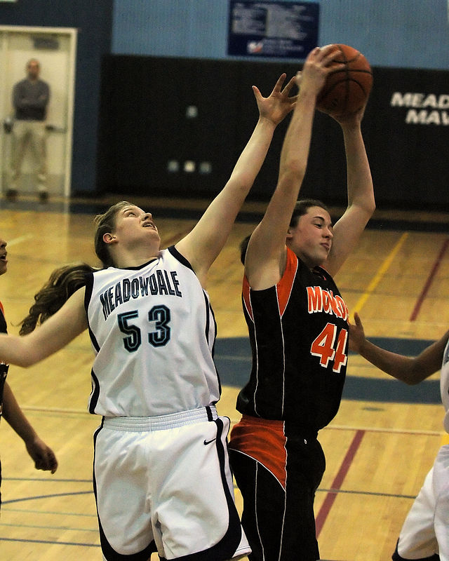 """For the Enterprise/John Kossik<br /> Meadowdale's Cassie Kosmides loses the rebound to Monroe's 6'2"""" Kelsey Brennan in the first half"""