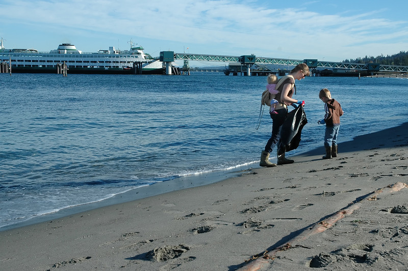 For the Enterprise/John Kossik<br /> Bryce Bardsley and his mom Jennifer were the first on the beach in front of Olympic Beach Plaza during Edmonds Coastal Clean Up Day.