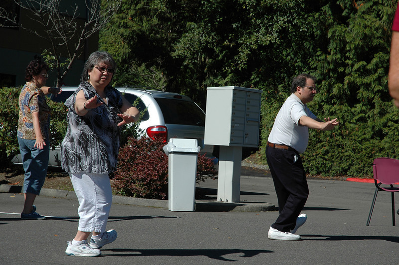 Nancy & Mike Lucero demonstrate tai chi at Mill Creek Senior Center Birthday Party