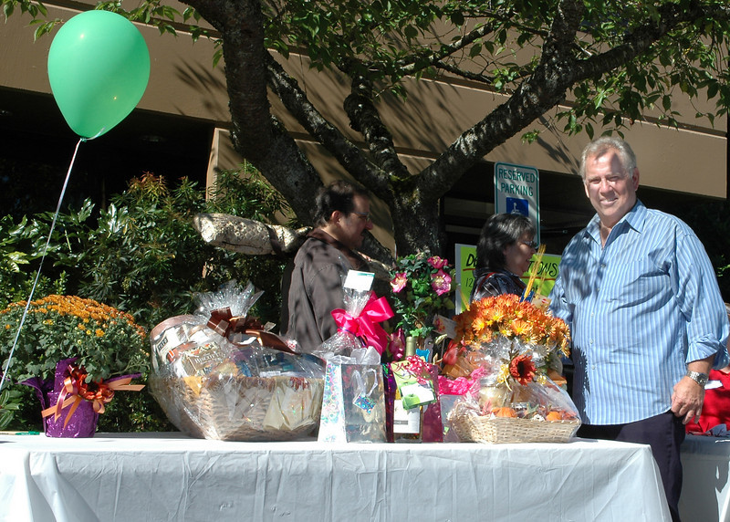 For the Enterprise/John Kossik<br /> Mill Creek Senior Center manager Bill Durham shows off door prizes donated for the Mill Creek Senior Center Birthday Party by local businesses.