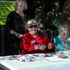 For the Enterprise/John Kossik<br /> Janet Chadwick, Georgia Machotka, and Lyndal Kennedy check attendees and hand out door prize tickets at the Mill Creek Senior Center Birthday Party
