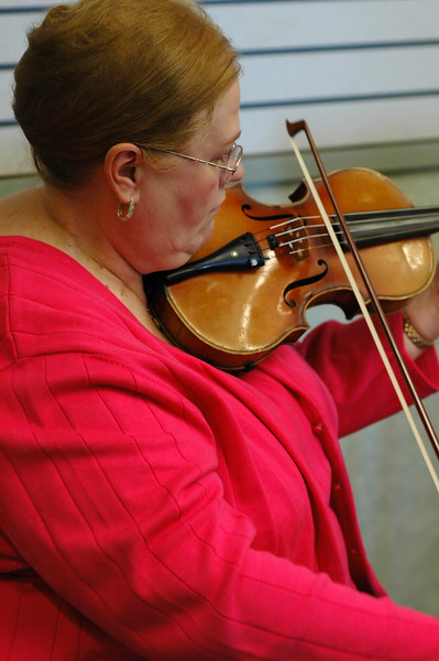 For the Enterprise/John Kossik<br /> Judi Tourigny plays the violin with others from the Cascade Symphony Orchestra at the Lynnwood Library for the opening of National Library Week