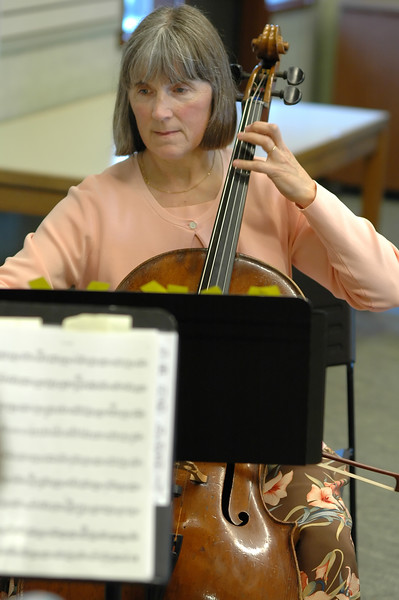 For the Enterprise/John Kossik<br /> Norma Dermond plays the cello with others from the Cascade Symphony Orchestra at the Lynnwood Library for the opening of National Library Week