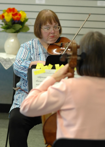 For the Enterprise/John Kossik<br /> Becca Gillette plays the violin with others from the Cascade Symphony Orchestra at the Lynnwood Library for the opening of National Library Week