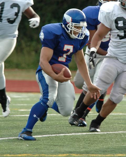 For the Enterprise/John Kossik<br /> Daimino Stewart turns the corner on the quarterback keeper