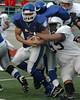 For the Enterprise/John Kossik<br /> Vikings quarterback Daimino Stewart is brought down by Raiders lineman