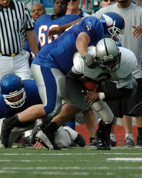 For the Enterprise/John Kossik<br /> Vikings defence brings down quarterback David Littleton of the Raiders
