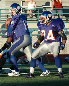 For the Enterprise/John Kossik Vikings quarterback John McCourt prepares to pass as running back Steve Casino stays back to protect him