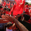 FMLN supporters waited in the midday sun for hours just for the opportunity to see presidential candidate Mauricio Funez speak.