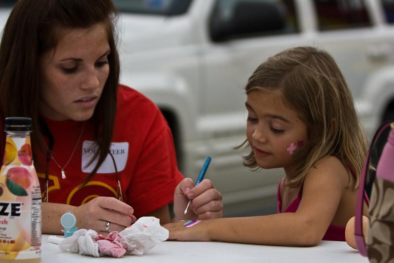 Nicole Demiraro of Chi Omega paints on Jenna Zitel's hand.