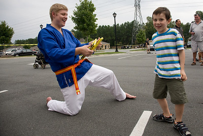 Chase Travland (right) practices his karate with Graham Cousar (left).