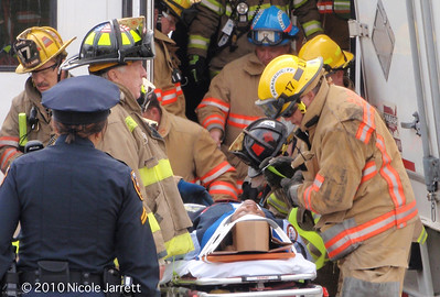 Firefighters pull the conductor from the Lightrail train that crashed into a tractor trailer truck in Hunt Valley early morning on March 23, 2010 at the corner of McCormic Road and Clubhouse Road. She was trapped for over twenty minutes while rescue workers tried to free her from the cabin of the train. Photograph by Nicole Jarrett