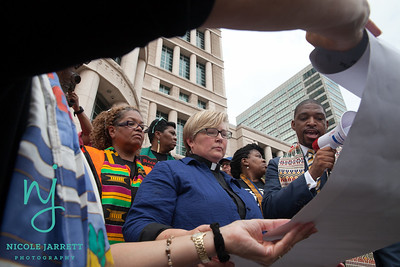 Clergy members read a list of demands to the DOJ on August 10, 2015. Photo Copyright Nicole Jarrett Photography, LLC