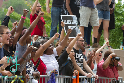 Protesters show support to those getting arrested for civil disobedience at the St. Louis City Courthouse on August 10, 2015. Photo Copyright Nicole Jarrett Alvarado.