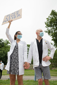 Tina Kiguradze, Washington University Neurology Resident, and Steven Machusko of the Department of Radiology participate in the White Coats for Black Lives protest in St Louis on June 5, 2020.