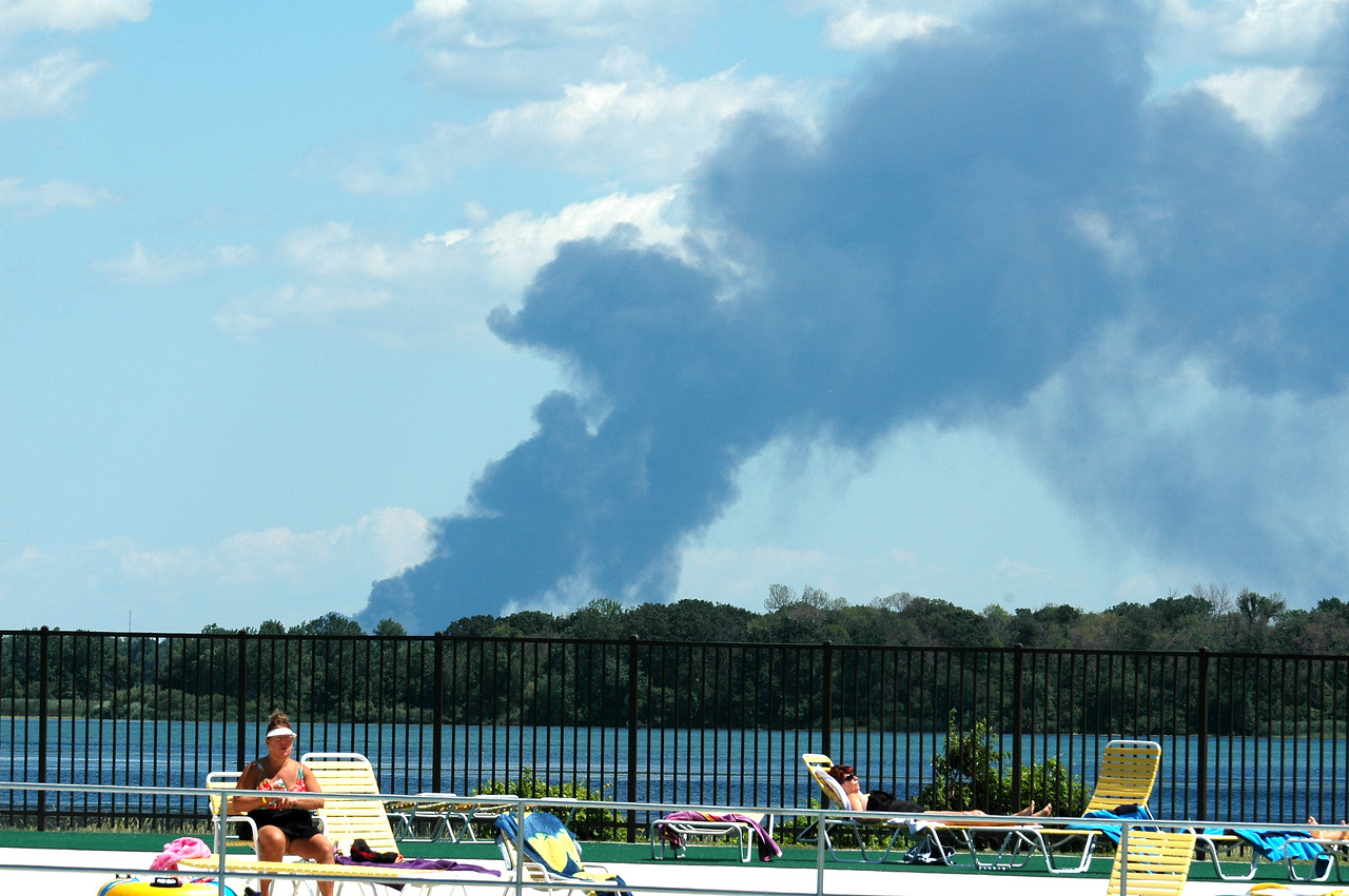 Thick smoke from the plastics recycling facility fire in Winsor Ontario can be see miles away across the Detroit River at a wave park in Wayne County Michigan