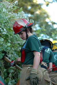 Fire Explorer Michelle Orton surveys the firebreak her team is creating.