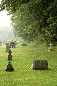 "Infant graves on the edge of St. Michael's Cemetery (on ""unblessed ground"") due to their death prior to baptism.    Augustine some 1500 years after his death still held sway over the actions of poor coal miners on the other side of the world. The practice continued in this rural town in Pennsylvania till at least the 1930's.  Thus, unconscious infants dying without this sprinkling are automatically damned to hellfire because they still have the inherited guilt. --Augustine of Hippo (354-430)"