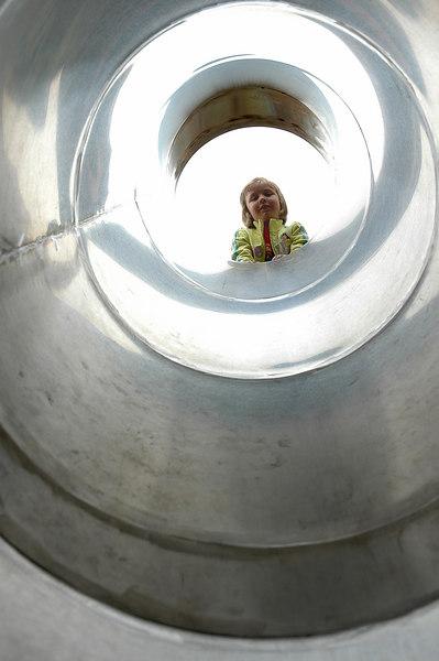 For the Enterprise/John KossikEmilia Peterson enjoys the new tunnel slide during the Hillside Park Dedication Ceremony