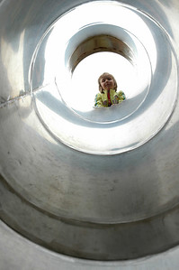 For the Enterprise/John Kossik Emilia Peterson enjoys the new tunnel slide during the Hillside Park Dedication Ceremony