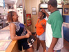 10:50 p.m. -- Newton High School twirler, Ashlee Hanks, 16, left to right, student, LaTisha Stewart, 17, and Newton football player, James Brooks, 17, hang out at the Dairy Queen after the Newton Eagles beat San Augustine Friday night in Newton.<br /> PHOTO/SCOTT ESLINGER                       OCT 1, 2004