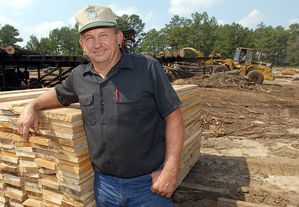1:30 p.m. -- Jimmy Walker, 49, who played football at Newton High School untill he graduated in 1973 and then at UT, poses for a photo at the family  sawmill he runs with his brother just South of Newton.<br /> PHOTO/SCOTT ESLINGER                       OCT 1, 2004