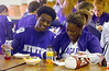 12:00 noon -- Newton High School quarterback, Sammy Adams, 17, left, and, cheerleader captian, Alysia Jackson, 17, enjoy lunch togther Friday at Newton High School, as Jackson writes a script for the upcoming afternoon's pep rally.<br /> PHOTO/SCOTT ESLINGER                       OCT 1, 2004