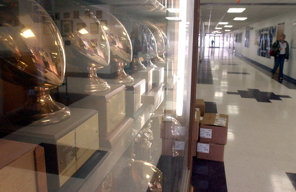 8:15 a.m. -- Trophies, many for football, fill most of a trophy case just inside the entrance to Newton High School Friday morning.<br /> PHOTO/SCOTT ESLINGER                       OCT 1, 2004