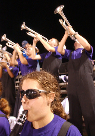 8:15 p.m. -- The Friday night lights are reflected in the sunglasses of Newton High School marching band member, Paulina Duhon, 16,  as the band plays during the sedcond quarter of Newton's game against San Augustine Friday night in Newton High School's Singletary Stadium.<br /> PHOTO/SCOTT ESLINGER                       OCT 1, 2004